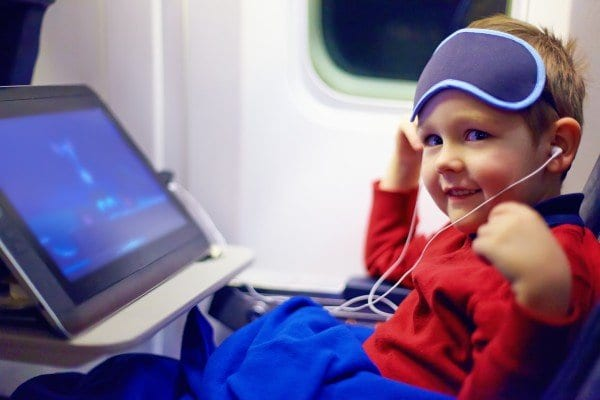 Child with tablet on airplane