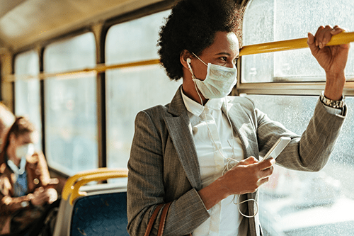 Woman on bus with mask